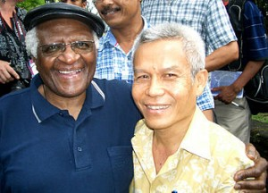Sombath Somphone (on right) with Desmond Tutu in 2006